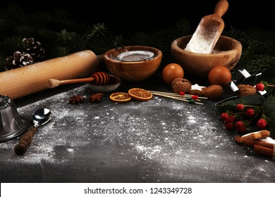 Baking christmas cookies ingredients for homemade pastry on wooden background with cookies and spieces.Typical cinnamon stars bakery for xmas with ingredients.