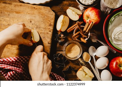 Baking concept of autumn apple pie. View from above on kitchen table. Cooking baking process with ingredients.