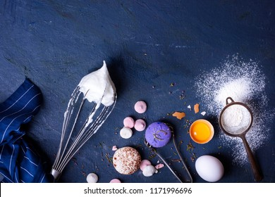Baking or cooking background frame. Ingredients, kitchen items for baking cakes. Kitchen utensils, flour, eggs, pastry. Text space, top view.