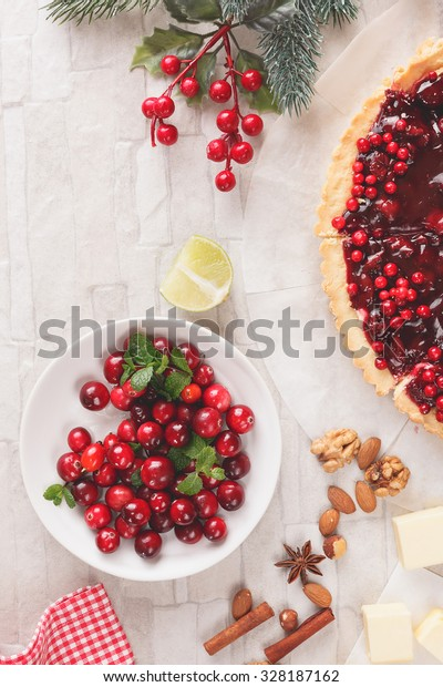 Baking with cranberries, Christmas setting.Vintage style with blank space, top view