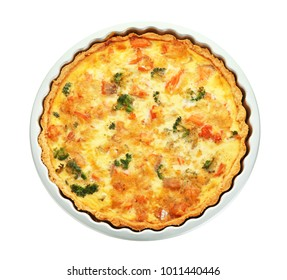 Baking dish with tasty broccoli quiche on white background