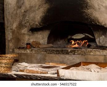 Baking flatbread on saj in outdoor oven in Nazareth Village, Israel