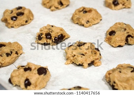 baking fresh homemade chocolate chip cookies on tray