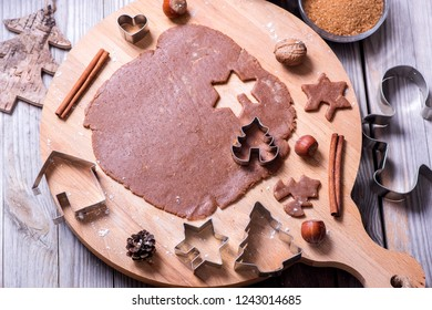 Baking gingerbread cookies, christmas cookies, raw dough and cutters, flat lay