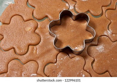 Baking gingerbread cookies, cutters with dough in flower form