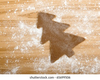 Baking homemade Gingerbread cookies with a shape of a christmas tree