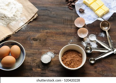 Baking Ingredients for a chocolate cake or brownie on a rustic wooden background