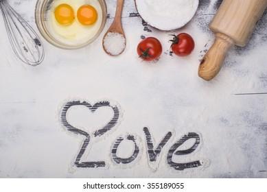 baking ingredients eggs, flour, sugar, butter, yeast. dough preparation. food background