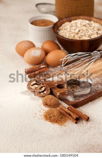 Baking ingredients - flour, cinnamon and baking forms on kitchen table