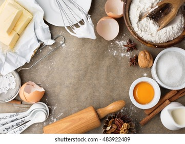 Baking ingredients for homemade pastry on baking paper background. Bake sweet cake dessert concept. Top view, flat lay style