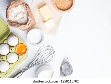 Baking ingredients and items on the white background, top view