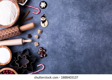 Baking ingredients on dark background with copy space