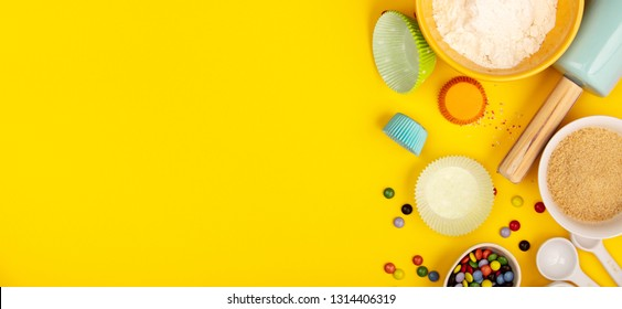 Baking ingredients on yellow background, flat lay
