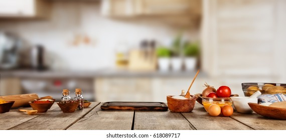 Baking ingredients placed on wooden table, ready for cooking. Copyspace for text. Concept of food preparation, kitchen on background. - Shutterstock ID 618089717