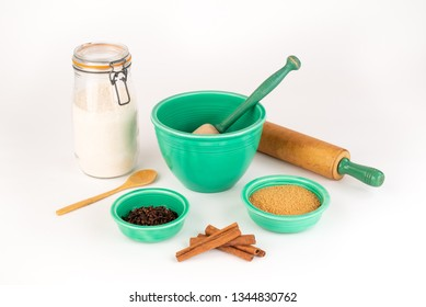 Baking Ingredients with Vintage Fiesta Ware Bowls and Antique Rolling Pin. Cinnamon, Organic Sugar, Wheat Flour in Glass Jar. Wooden Spoon.