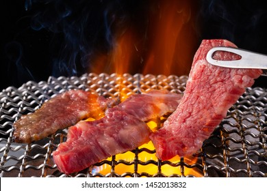 Baking meat at a yakiniku restaurant