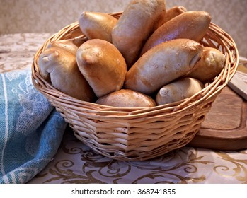 baking pies with rice and meat , in a wicker basket