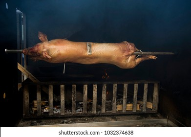 Baking a piglet on fire. Piglet on the roasting-jack