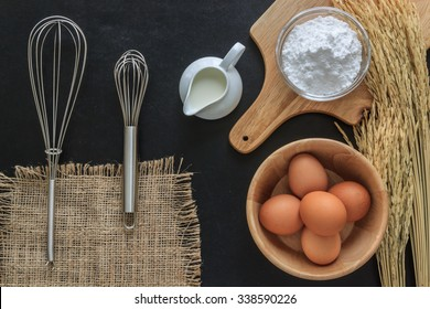 Baking powder milk and eggs on chalkboard