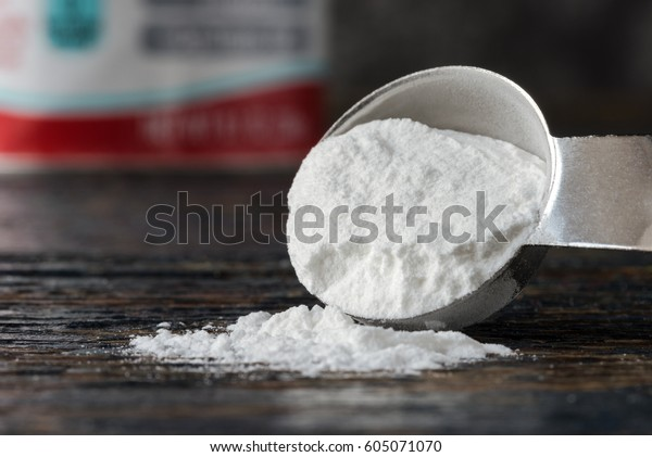 Baking Powder Spilled from a Teaspoon