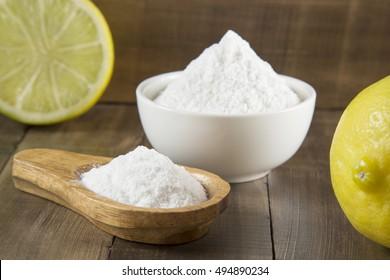 Baking soda and lemon on wooden table