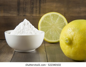 Baking soda and lemon on wooden table