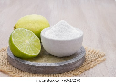 Baking soda with lemon on wooden background