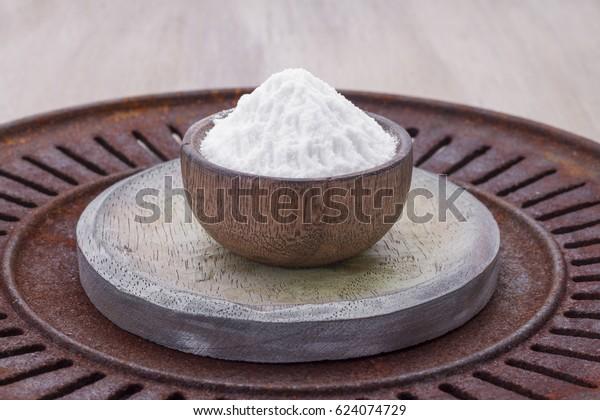 Baking soda with lemon on wooden background