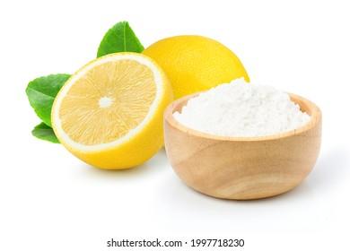 Baking soda or sodium bicarbonate powder and frresh lemon fruit isolated on white background.