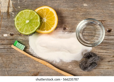 Baking soda, water, lemon, sponge, toothbrush and steel wool
