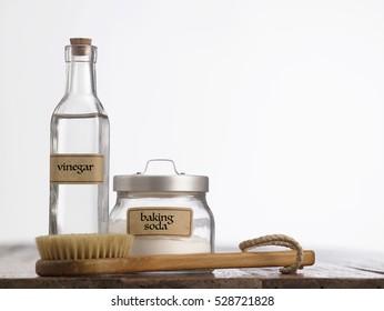 baking soda with white vinegar and brush on the white background