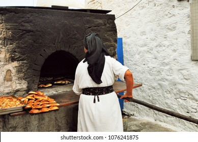 Baking special bread at Olympos village, Karpathos island, Greece.