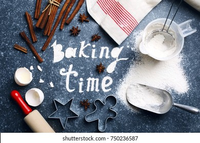 Baking time. Flour sprinkled on the blue table with text baking time. Baking ingredients.