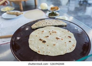Baking traditional Turkish borek, pide, pita or yufka bread. Borek, bread or pastry dough  on the oven. Traditional Turkish food culture or cuisine.