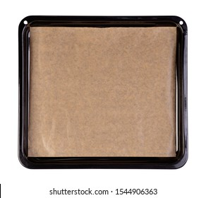 Baking tray with brown baking paper isolated on white background