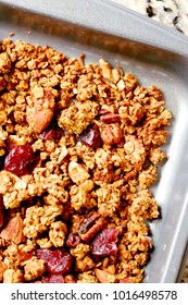 Baking Tray of Homemade Cranberry Granola with Nuts
