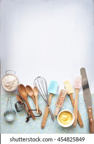 Baking utensils and ingredients on pastel light blue background. Flat lay bakery text space images.