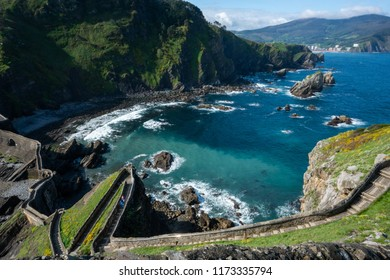 Bakio, Biscay / Spain - Abril 2, 2018: Gaztelugatxe islet in Spain's Basque Country views of hill, stairs, beach and church.