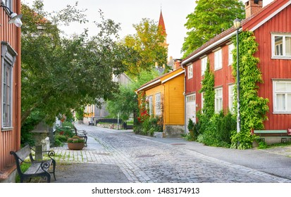 Bakklandet - residential district with old timber houses and narrow street in the Norwegian city Trondheim