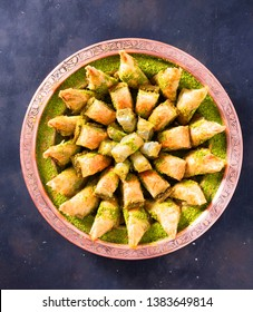 Baklava or baklawa is a rich, sweet pastry featured in many cuisines of the former. Turkish Ramadan Dessert Baklava with concept background