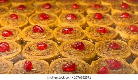 Baklava fresh from the oven with cherries and honey