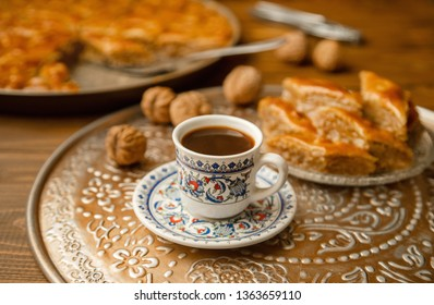 Baklava with nuts on a wooden background. Selective focus. food and drink.