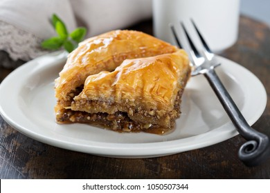 Baklava on a dessert plate with a cup of coffee