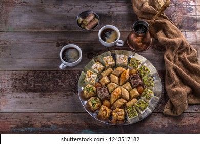 Baklava with pistachio and honey in traditional plate, copy space