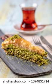 Baklava with pistachio. Turkish traditional dessert and Turkish Tea. Turkish name; havuc dilimi baklava .