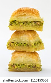 Baklava with pistachios and honey on white background. Jewish, turkish, arabic traditional national dessert. Macro and selective focus.