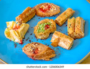 Baklava sweets, snacks up for grabs.  Baklava is a rich, sweet pastry made of layers of filo filled with chopped nuts