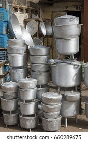 BAKOTEH, THE GAMBIA - MAY 08, 2017: Pans and other kitchen utensils, at the door of a trade facing the market