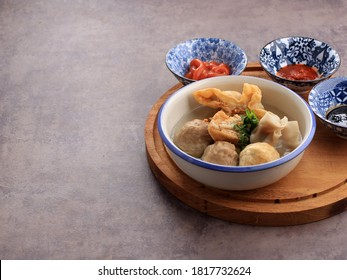Bakso Malang, Meatball Soup with Various Side Dish like Tofu Fried Shiumay, or Bakso Goreng. Served on the Table with Sambal, Soysauce, and Tomato Sauce. Selected Focus