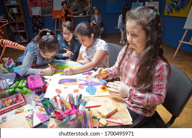 Baku, Azerbaijan. 14.05.2019 . The children painted. Kids draw . Children painting . The children draw pictures  Museum center exhibition hall